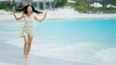 Young ethnic Asian Chinese girl barefoot on Caribbean beach - stock footage