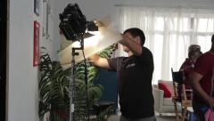 Film illuminator at work. Installation of lighting equipment. Film production - stock footage