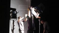Film crew at work. Lighting install lighting equipment. Film production - stock footage