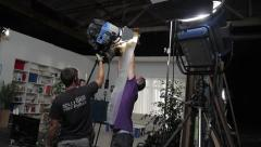 Installation of lighting in the scenery of the film. Film production - stock footage
