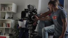 The cameraman and focuspuller at work on a professional camera. Film production Stock Footage