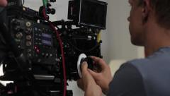 Focuspuller manages the focus on the camera while filming. Film production Stock Footage