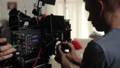 Focuspuller at work on the filming of the movie. Film production Stock Footage