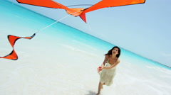 Barefoot Asian Chinese girl on beach playing with kite Stock Footage