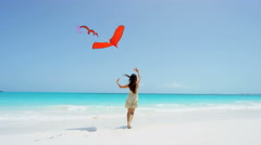 Beautiful young ethnic Asian Chinese girl with red kite on beach - stock footage