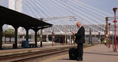 Sales Agent Travel Business Waiting Departure Train Station Platform Read News - stock footage