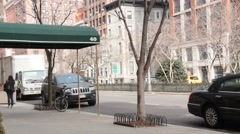 SUV Traveling Left to Right Down Park Avenue in Murray Hill NYC Stock Footage