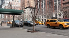 Town Cars an Taxis Move Slowly Down Park Avenue in NYC Stock Footage