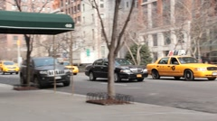 Town Car and Taxis left to right down Park Avenue NYC Stock Footage