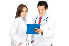 Bad Reaction Asian Hispanic Doctors Team Charts H Stock Photos