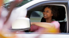 Portrait of happy confident African American female buying new car - stock footage