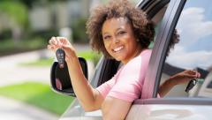 Portrait of young confident African American woman with car insurance - stock footage