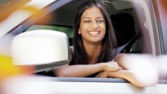 Portrait of young confident Indian American woman with car insurance - stock footage