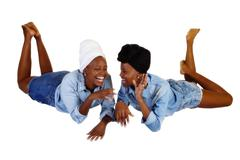Stock Photo of Two Black Sisters Reclining Open Mouth Laugh