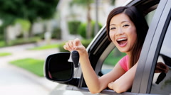 Portrait of young attractive Asian American female in rental car on holiday - stock footage