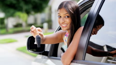 Portrait of young happy Indian American woman driving first vehicle - stock footage