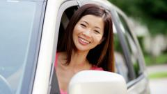 Portrait of young happy Asian American female in rental car on vacation - stock footage