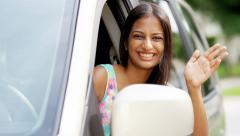 Portrait of young happy Indian American woman driving first car - stock footage