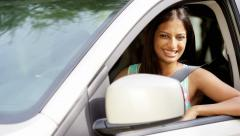 Portrait of happy confident Indian American female with car insurance - stock footage