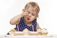 Little baby girl with sweets - stock photo