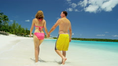 Young Caucasian couple in swimwear on a luxury beach vacation Stock Footage