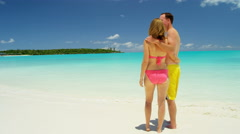 Loving young Caucasian couple in swimwear on a tropical beach - stock footage