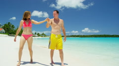 Loving young Caucasian couple in swimwear at a tropical beach resort - stock footage