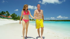 Young Caucasian couple in swimwear on a luxury beach vacation - stock footage