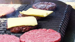 Burger shop - hamburgers with cheese and on grill Stock Footage
