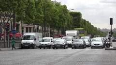 Traffic pull away from lights, Champs Elysees (in 4k), Paris, France. Stock Footage
