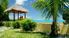 Caucasian couple in a tropical beach hut Stock Footage