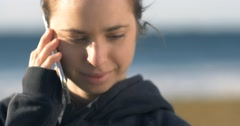 Female girl on mobile cell phone thinking looking happy Stock Footage