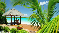 Caucasian couple outdoors in a tropical beach hut Stock Footage