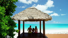 Caucasian family outdoors in a tropical beach hut Stock Footage