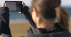 woman taking photographs using mobile cell phone camera - stock footage