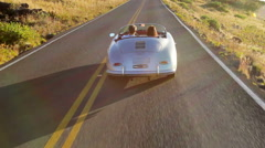 Happy Couple Driving Classic Convertible Car Stock Footage