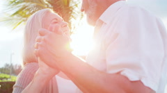 Senior Caucasian couple dancing together by a Caribbean beach Stock Footage