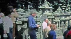 SINGAPORE 1973: Seniors touring southeast Asian ancient temple ruins. Stock Footage