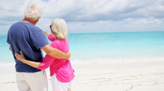 Retired senior Caucasian couple enjoying a tropical vacation - stock footage