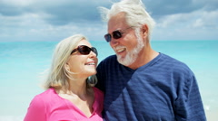 Portrait of loving retired Caucasian seniors outdoor on the beach - stock footage