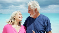 Portrait of Caucasian senior retired couple enjoying the beach - stock footage