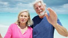 Portrait of loving retired Caucasian seniors outdoor on the beach - stock footage