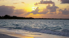 Time lapse of tropical island ocean at sunset Stock Footage
