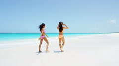 African American and Asian Chinese girls on beach vacation Stock Footage