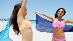 Multi ethnic girlfriends wearing tropical beach swimwear - stock footage