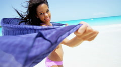 Smiling African American girl in swimwear and scarf on beach Stock Footage