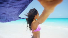 Smiling African American girl in swimwear on beach vacation Stock Footage