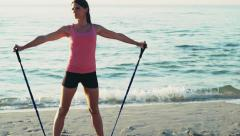 Young female works out on the beach slow motion Stock Footage