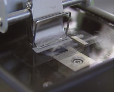 Laboratory microtome cuts a thin slice of rat brain tissue Stock Footage