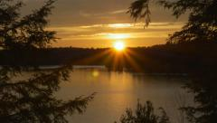 Orange sunset on the lake. Muskoka, Ontario. Stock Footage